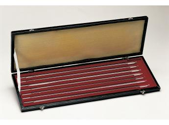 Case with 7 glass rod mercury thermometers, white back, scale in 0.1 °C.